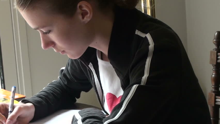1920x1080 a beautiful young girl writes, concentrates.  - HD stock footage clip