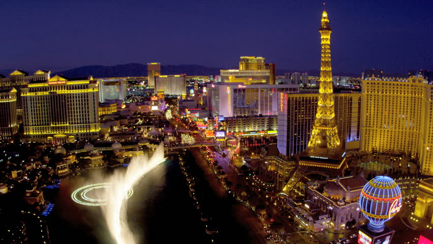 Illuminated view Paris hotel Eiffel Tower nr Bellagio fountains, Las Vegas Strip, USA
