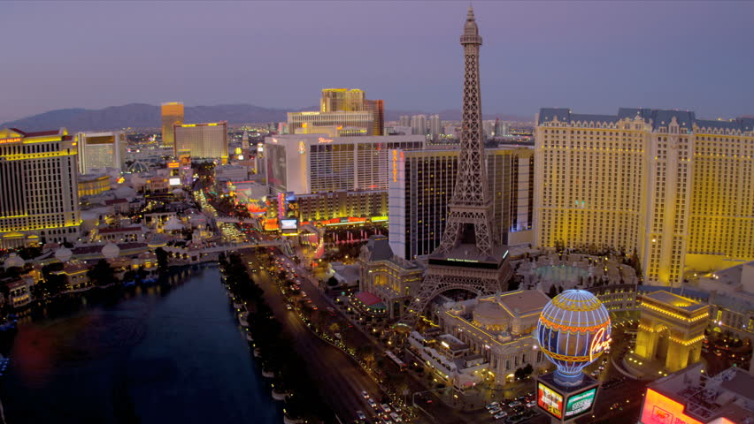 Illuminated Las Vegas Blvd. at dusk hotels and Casinos, USA | Shutterstock HD Video #4206565
