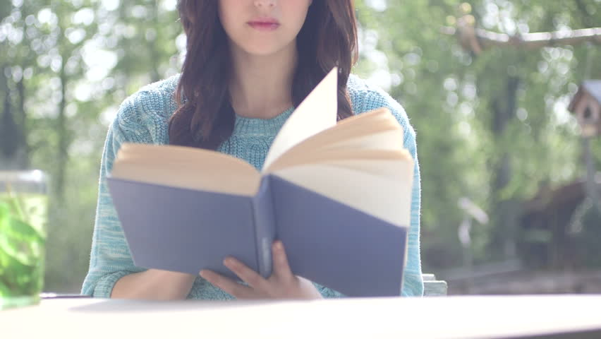 Young woman reading and drinking mint tea - HD stock video clip