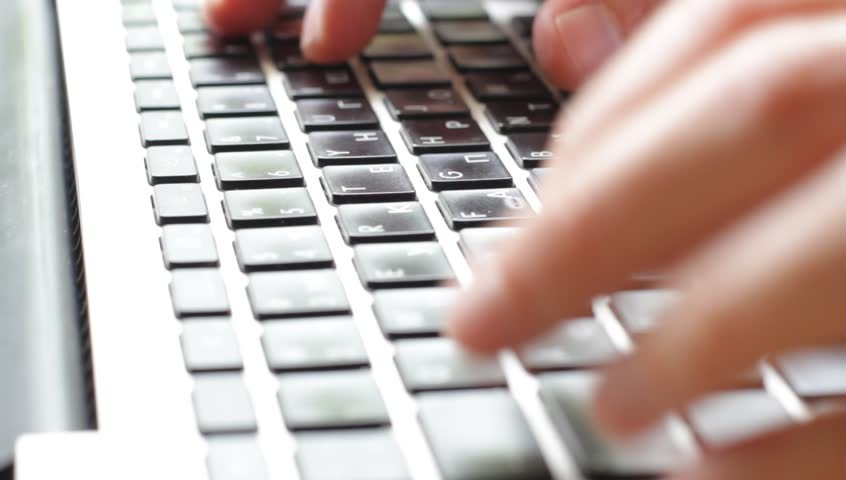 Man hands typing on a computer keyboard - HD stock footage clip