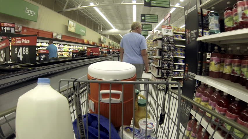 EPHRAIM UTAH JUL 2013: Food cereal breakfast shopping POV. Busy store shopping for summer vacation holiday. Economic stability to small rural community. Local employment and sales tax benefit. - HD stock footage clip