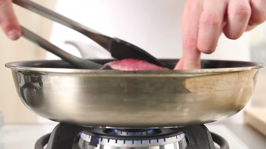 Duck breast being turned in a pan - HD stock footage clip
