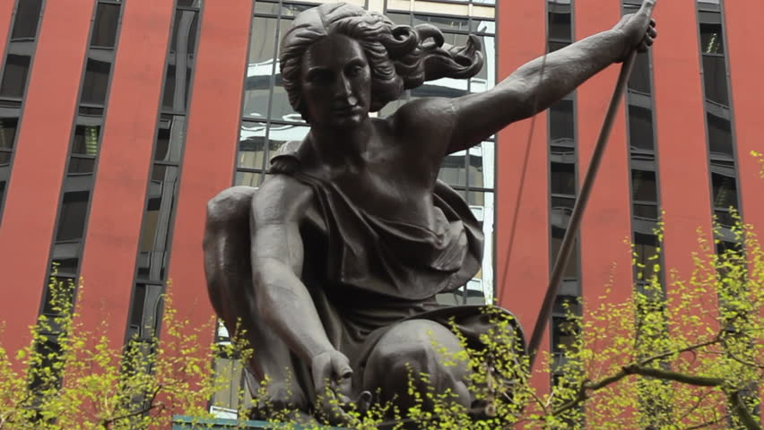 Portland, Oregon - April, 2013 - Low angle medium shot of the Portlandia statue on top of the entrance of the Michael Graves' Portland Building in downtown.