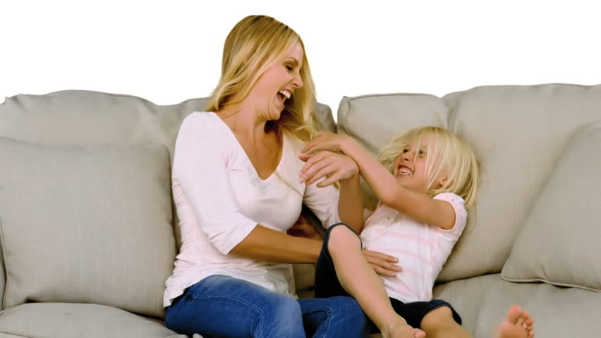 Mother and daughter having fun in slow motion on white background - HD stock footage clip