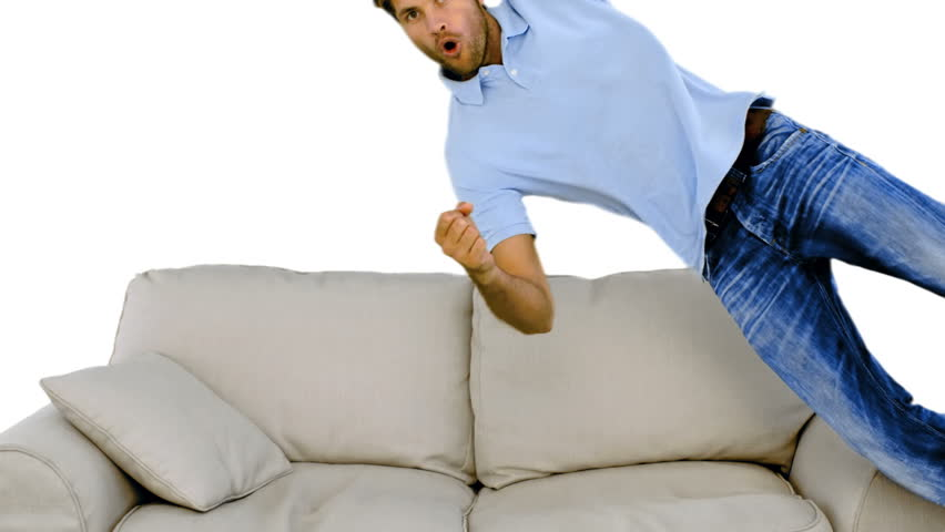 Man Jumping On The Sofa On White Background In Slow Motion