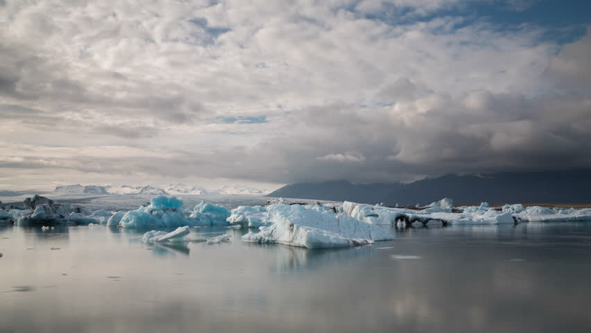 Time lapse of blue icebergs floating in Jokulsarlon glacial lagoon, Iceland (4K version available)
