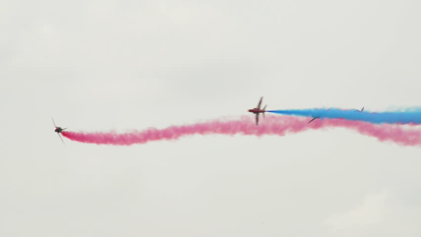VOLKEL, NETHERLANDS - June 14 2013: Four jets from the RAF Red Arrows crossing close together during an airshow at Volkel, Netherlands, June 14, 2013
