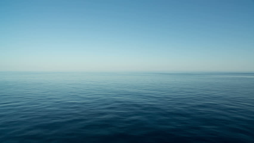 Peaceful and calm shot of a gently lapping sea and nice sky  | Shutterstock HD Video #4228975