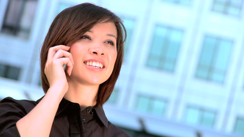 Smart city businesswoman talking on a mobile(cell) phone - HD stock video clip
