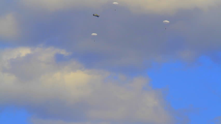 release of parachutists from the plane shooting parachute jumps (skydiving) from a distance
