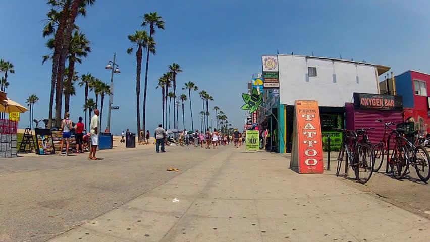 VENICE BEACH, CA/USA: July 18, 2013- The camera rolls down the boardwalk past a medical marijuana dispensary shop circa 2013 in Venice Beach. Venice Beach is a major tourist destination / landmark.