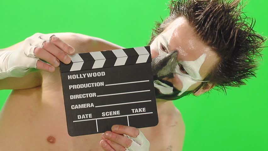 Stock Video Footage Clown with smal cinema clapboard