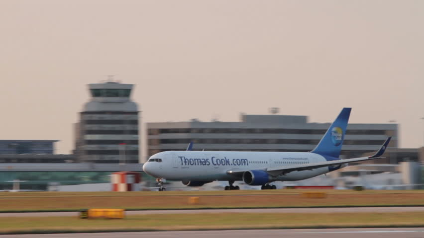MANCHESTER, LANCASHIRE/ENGLAND - JULY 17: Thomas Cook Boeing 767 plane takes off at sunset on July 17, 2013 in Manchester. Thomas Cook Airlines a charter airline based in Manchester.
