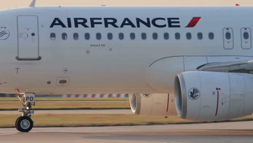 MANCHESTER, LANCASHIRE/ENGLAND - JULY 17: Close up of Air France Airbus A320 plane taxis down the runway for take off on July 17, 2013 in Manchester. Air France merged with KLM in 2003.