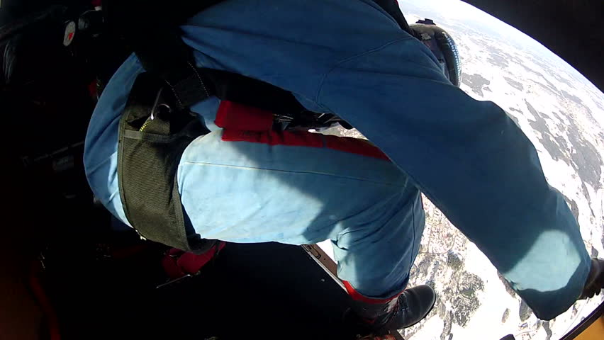 A skydiver jumps out of a plane with a camera attatched to his helmet. You see his point of view until he has opened his parachute and looks down at the ground.