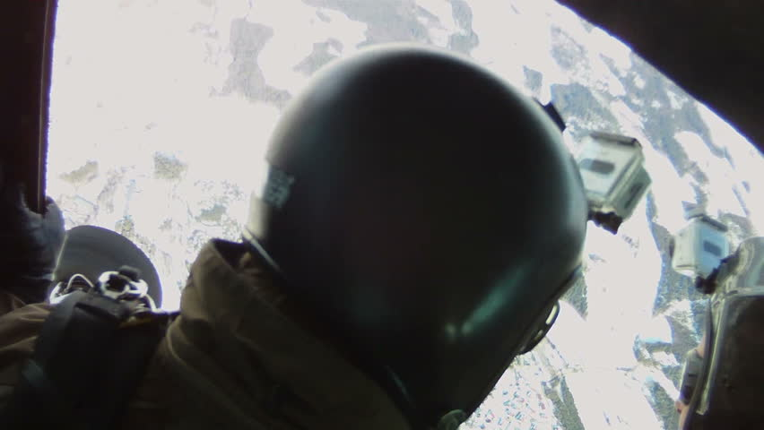 Several skydivers jumps out of a plane with a camera attatched to his helmet. One of them has a camera attached. Point of view until he has opened his parachute and looks down at the ground.