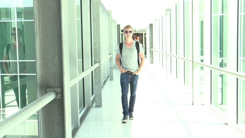 Young attractive man walking to camera