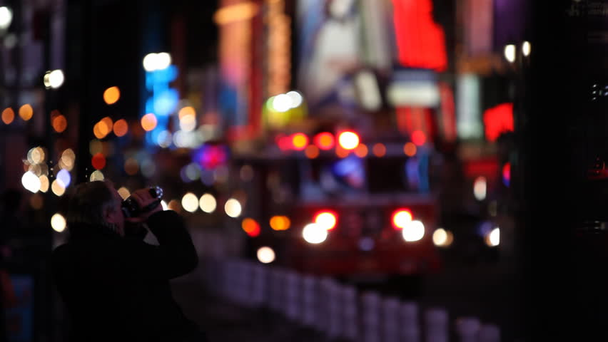 A man filming the Times Square with a small video cam (lighter in original) / HD1080 / 29.97fps - HD stock footage clip