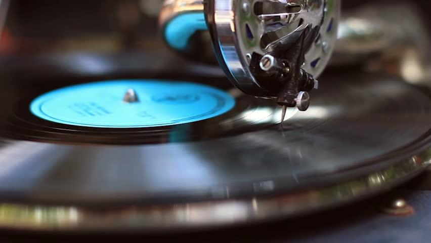 Retro gramophone playing, big fashionable needle scrapes record making music