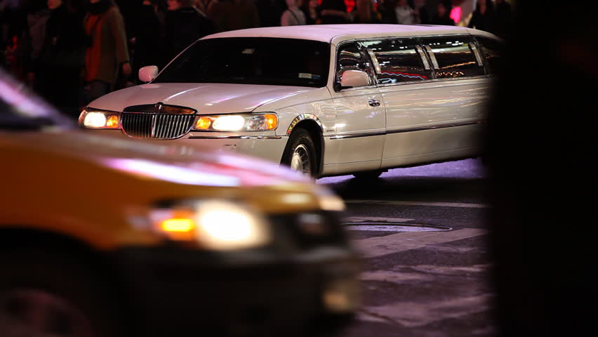 White Limousine stuck in traffic on Times Square Manhattan, New York City /