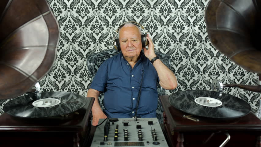 a very funky elderly grandpa dj mixing records with gramophones