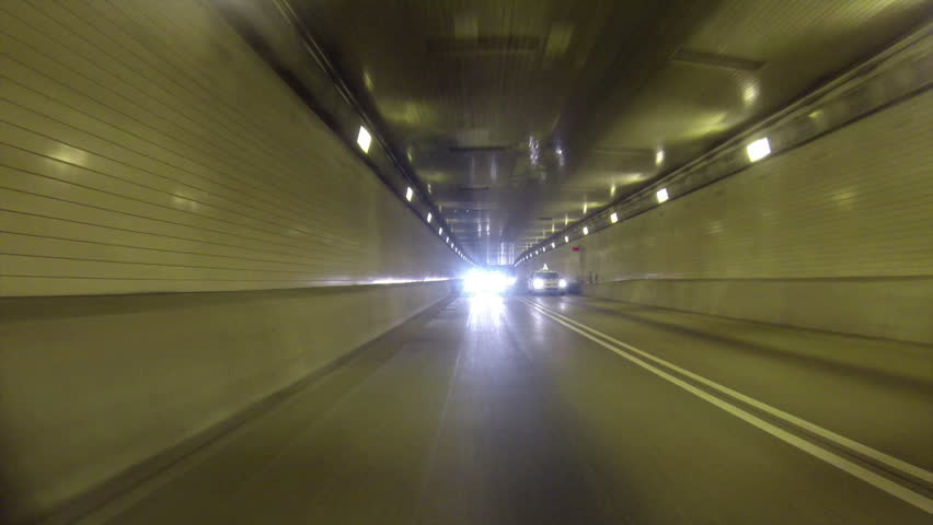 A rear view perspective of driving into the Fort Pitt Tunnel in Pittsburgh, Pennsylvania. - HD stock video clip