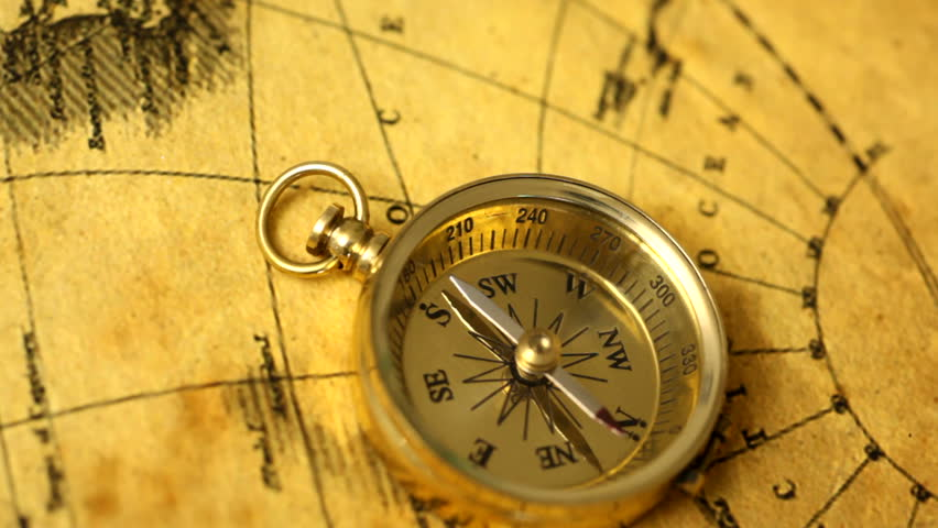Golden compass on antique map - HD stock footage clip
