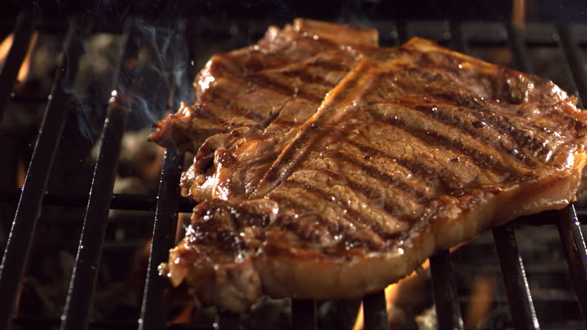 T-bone steak on barbecue grill