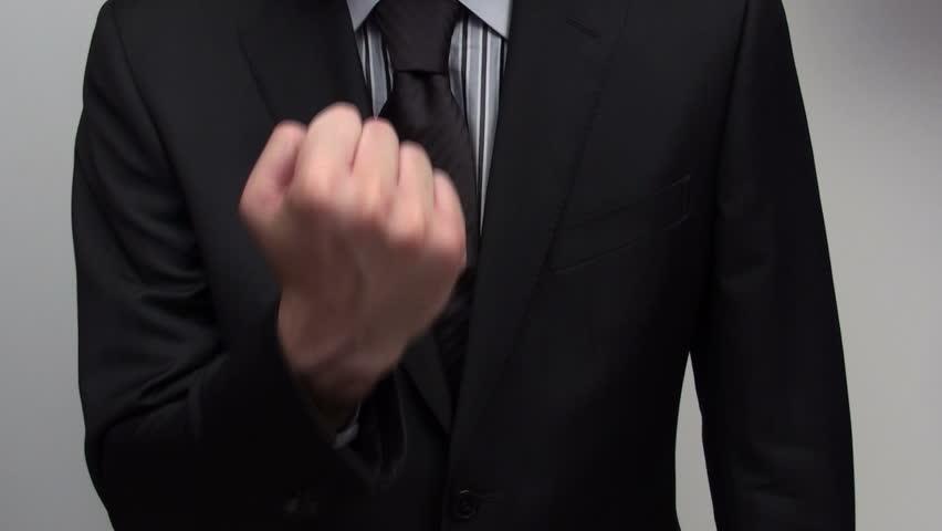 Businessman gives finger