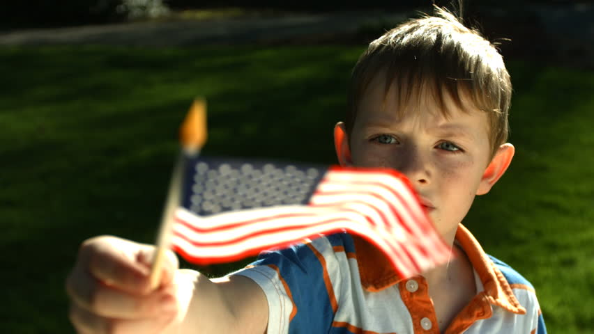 Young boy waving flag, slow motion