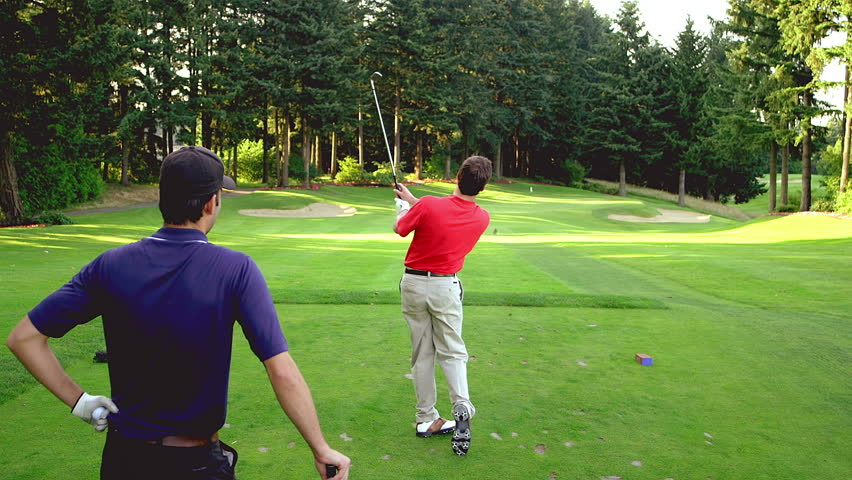 Man tees off on golf course - HD stock footage clip