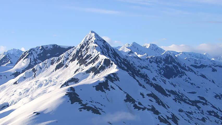 Aerial shot of snowy mountain peak, Alaska