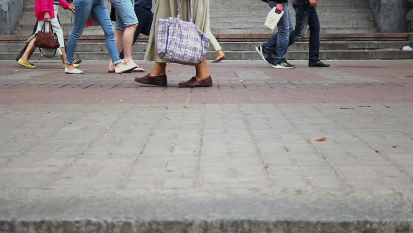 Different people walking on city pavement tiles, crowd feet walk