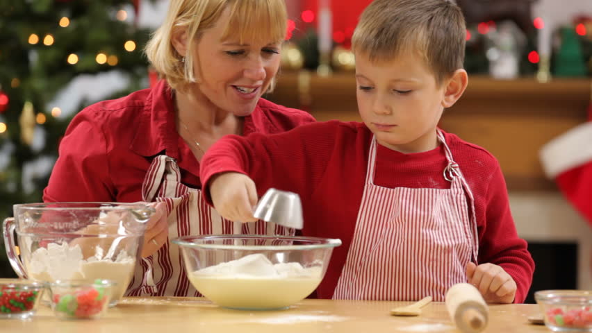 Mother and son baking Christmas cookies