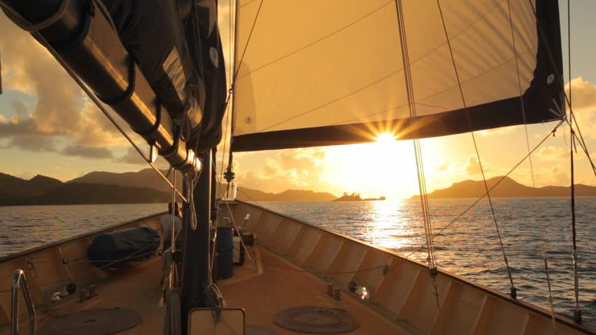 on sailing boat towards sunset