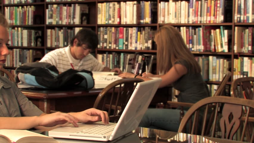 Students study in the library. - HD stock video clip