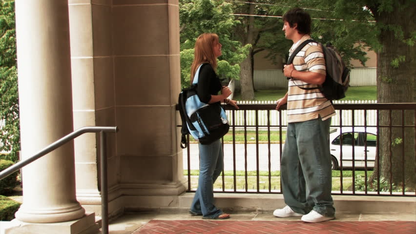 Students meet outside the library on a college campus. - HD stock footage clip