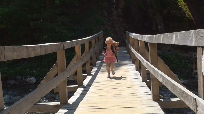 Child Running on a Bridge over a Mountain River, Little Girl Tourist in a Trip, Children