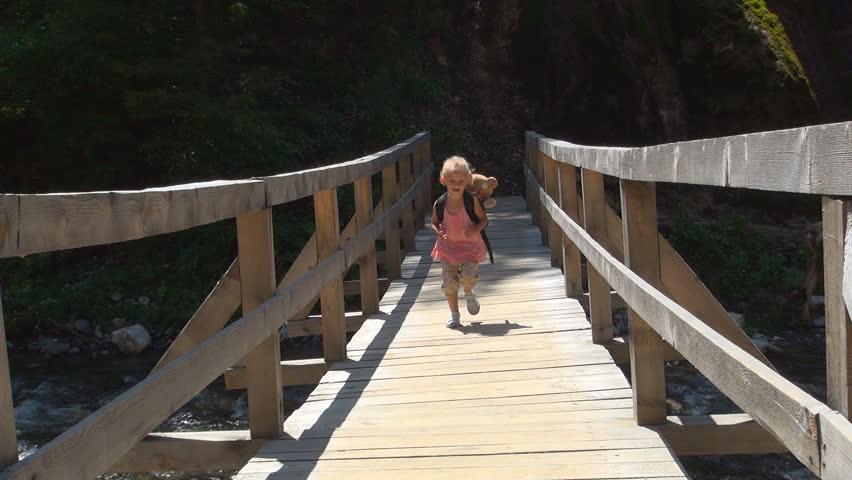 Child Running on a Bridge over a Mountain River, Little Girl Tourist in a Trip, Children