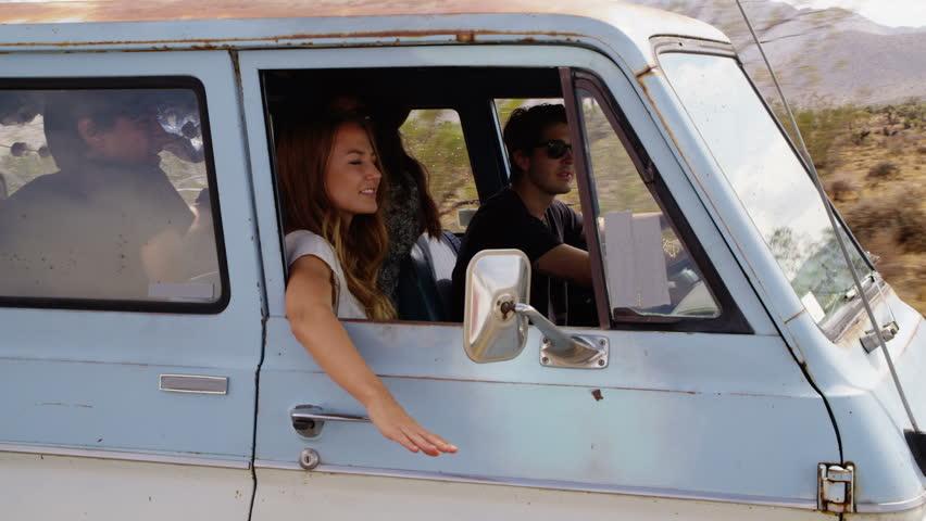 Friends riding in van