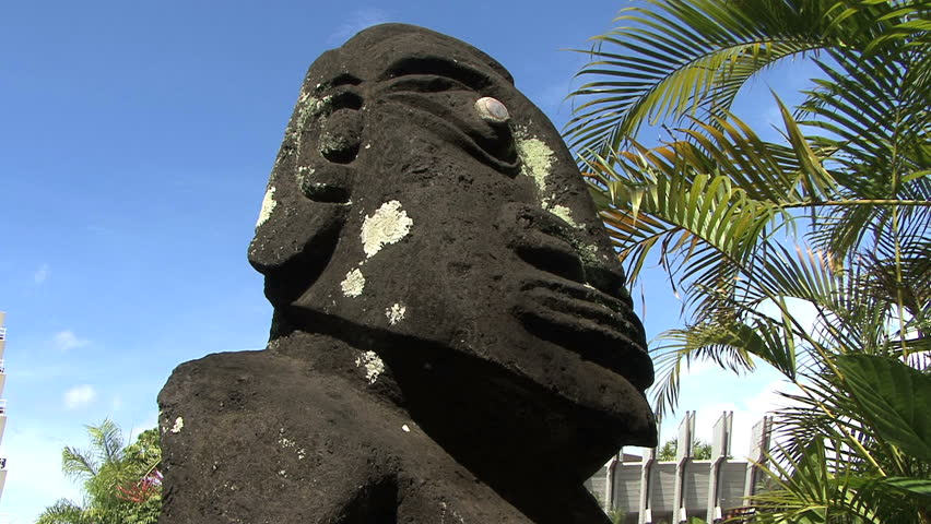 Tahiti stone tiki face - HD stock video clip
