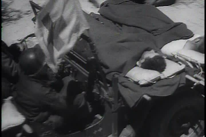 1940s - Invasion of Normandy footage in World War Two and treatment of the wounded.