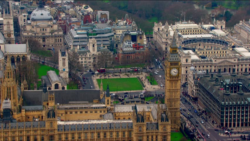 Panoramic aerial view of The Houses of Parliament (Palace of Westminster) in Central London, UK. Features Big Ben, The Treasury Building and the River Thames.
