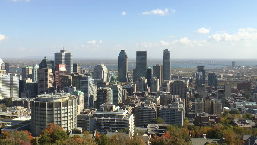 Time Lapse Of Montreal downtown skyline as seen from the lookout at Mount Royal, the St Lawrence River is visible in the distance which is part of the St Lawrence Seaway.