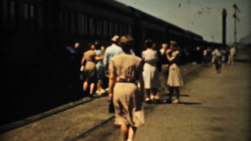 MINNEAPOLIS, MINNESOTA - CIRCA 1940: A group of people begin their cross country train trip riding the Challenger in style in 1940. - HD stock footage clip