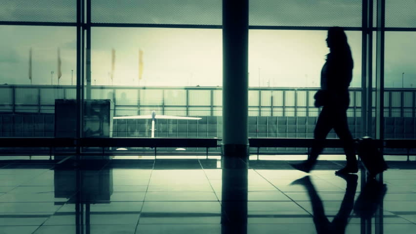 Passengers walking inside the air terminal/Airport lounge