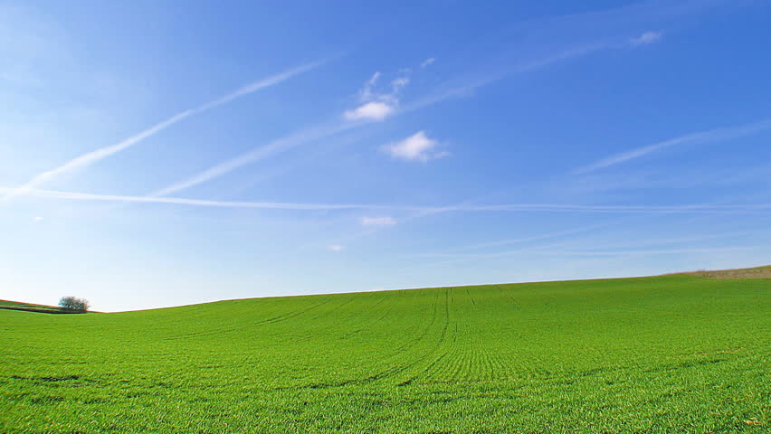 Time lapse, white clouds passing over green hills (windows xp background style !) - HD stock footage clip
