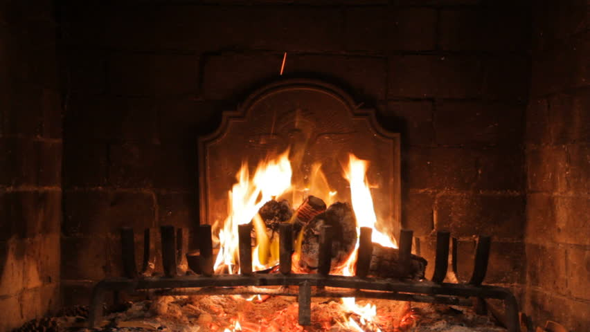 A looping clip of a fireplace with medium size flames.