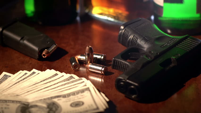 True Crime Or Film Noir Style Shot Of Bullets Dropping In ...